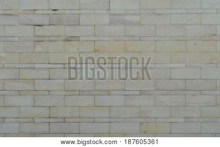 Pattern of sand stone tile wall in pastel color