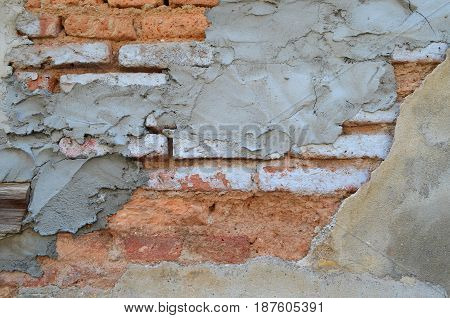 Damaged And Decay Old Brick Wall With Cement Plaster