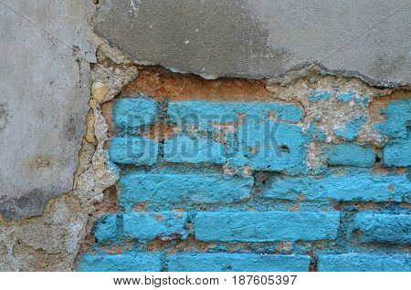 Damaged And Decay Old Blue Painted Brick Wall With Cement Plaster