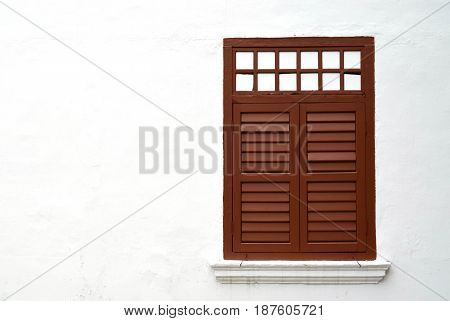 Brown vintage wooden window on white wall with copy space