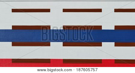 White and red and blue painted on modern building - exterior decoration