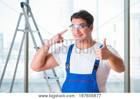 Young worker with safety goggles