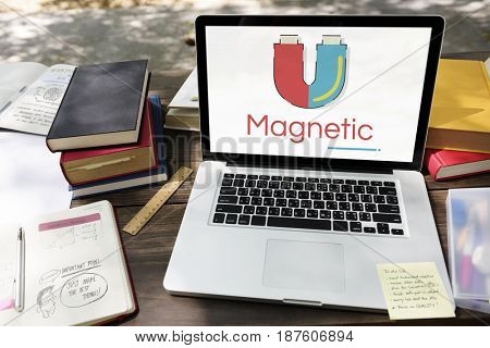 Illustration of horseshoe magnetic field energy on laptop