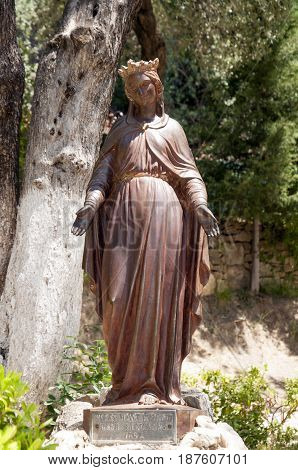 Statue of the Virgin Mary in yard of The House of the Virgin Mary, Ephesus, Turkey