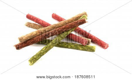 Colorful dog food isolated on white background