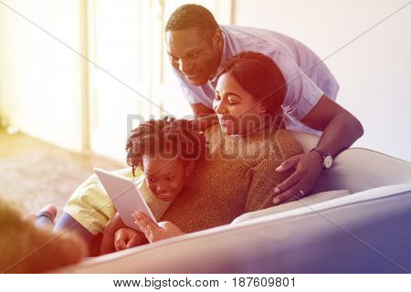 African Family Use Tablet Sit Sofa