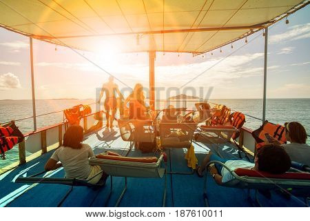 tourist relaxing on cruising ship roof and sun light skies ahead