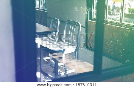 Empty metal seats in a cafe