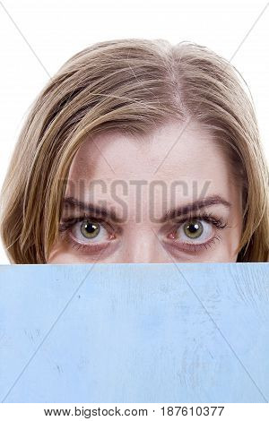 Green eyes of a young woman close-up