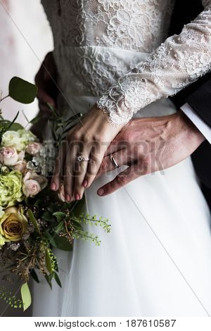 Bride and Groom Showing Their Engagement Wedding Rings on Hands