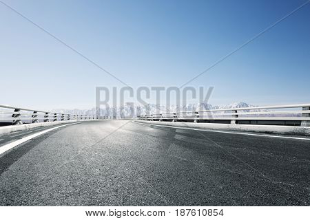 empty road with beautiful snow mountain