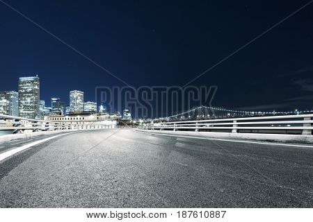 empty road with landmark buildings in san francisco at night