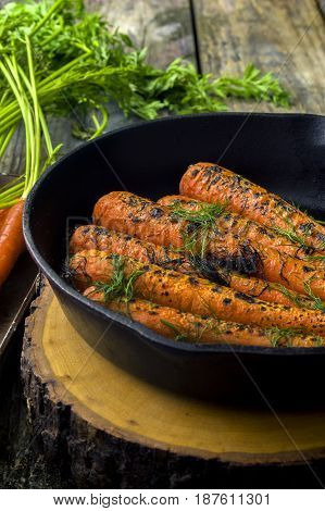 fresh baked carrots in an iron skillet