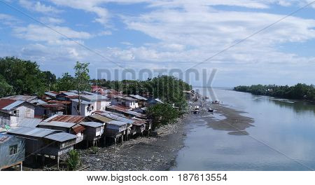 Houses on stilts by Bangkerohan River, Davao City The land disappears underneath the houses on stilts at the Bankerohan River in Davao City when the tide comes in from the sea.