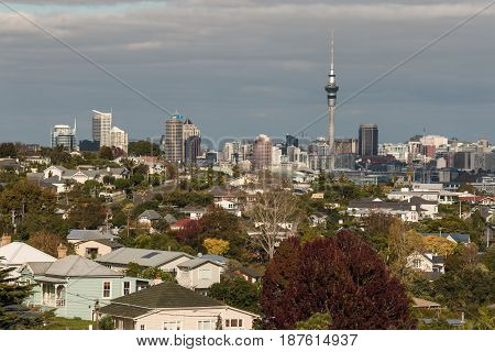 AUCKLAND, NEW ZEALAND - MAY 5, 2015: aerial view of Auckland suburb with skyscrapers in background