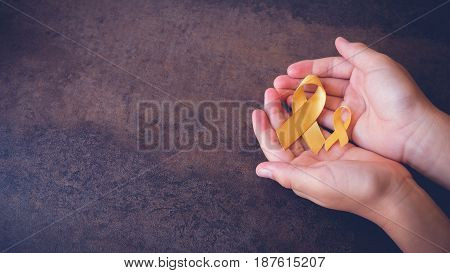 Yellow Gold Ribbons On Hands, Sarcoma Awareness, Bone Cancer, Liver Cancer, Bladder Cancer, Childhoo