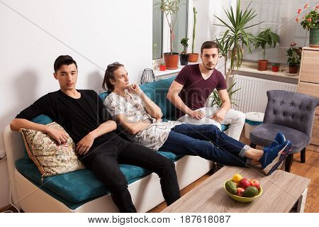 Friends hanging out together in nice confortable room. Male friendship