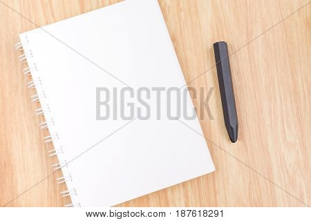 Close Up Blank Open Ring Binder Notebook With Black Pencil On Wood Table,business Template Mock Up F