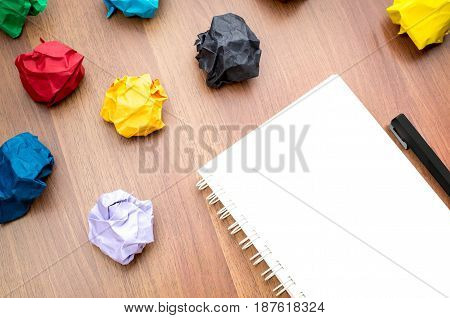 Open Blank Ring Binder White Book And Pencil With Group Of Colorful Crumpled Paper Ball On Dark Brow