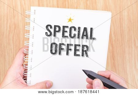 Special Offer Word On White Ring Binder Notebook With Hand Holding Pencil On Wood Table,business Con