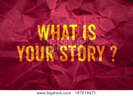 What is your story? in gold texture on crumpled red paper backgroundbusiness concept.