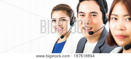 Asian call center (telemarketer) team - panoramic banner background with copy space