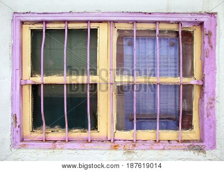 Old Window Painted Yellow And Pink