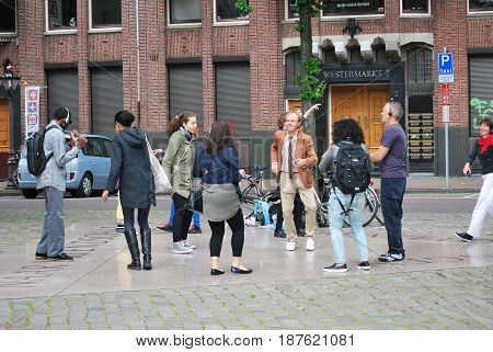 MAY 31, 2014. AMSTERDAM, NETHERLANDS. CIRCA:  Office worker having a block dance party after work in Amsterdam.