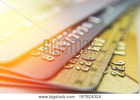 Gold and platinum credit cards close up.