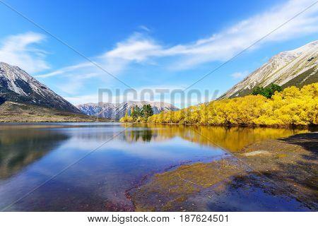 Beautiful scenery of Lake Pearson (Moana Rua) in Autumn with reflection Arthur's pass National Park South Island of New Zealand