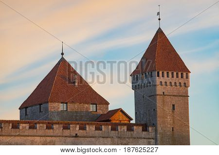 Kuressaare Episcopal Castle towers in sunrise light against wonderful sky Saaremaa Estonia