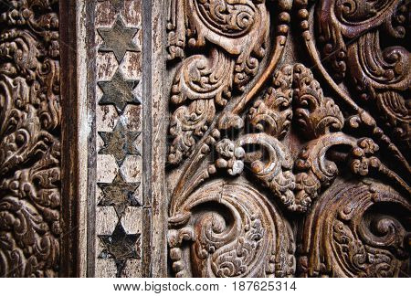 Beautiful wood carving on ancient door in Buddhist temple in Kandy Sri Lanka.