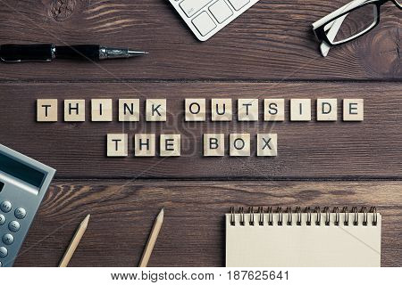 Thinking outside the box concept spelled with game elements