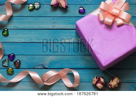 Gift box on a blue wooden background