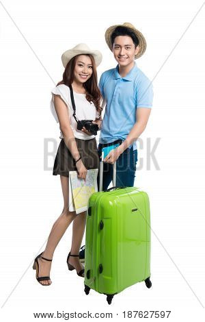 Full Length Of Young Asian Couple Ready To Travel During Summer.