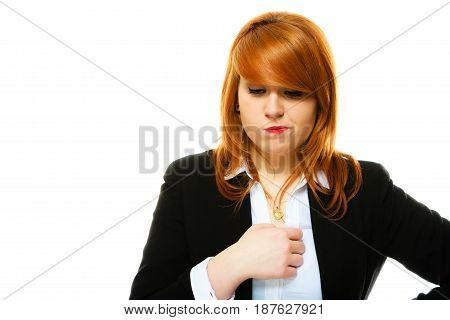 Portrait of funny redhair business woman or student girl full of doubts and hesitation. Studio shot isolated on white background