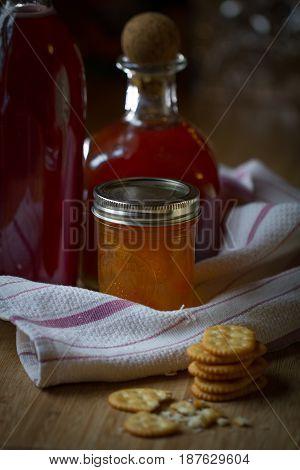 Jars of homemade jams and syrups on a counter