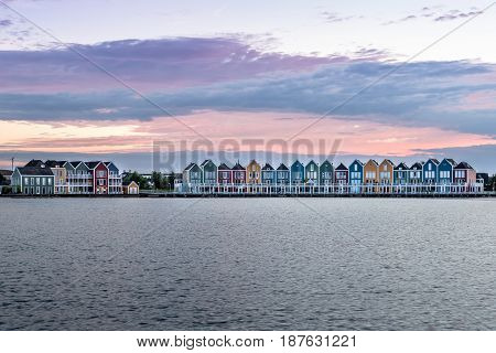 Houten Netherlands - August 4 2016: Calm evening at the famous Rainbow houses in the Netherlands. Colored wooden houses.