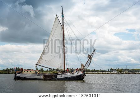Enkhuizen Netherlands - August 5 2016: Old sailing ship in the harbour. At the peak of its power Enkhuizen was one of the most important harbour cities in the Netherlands