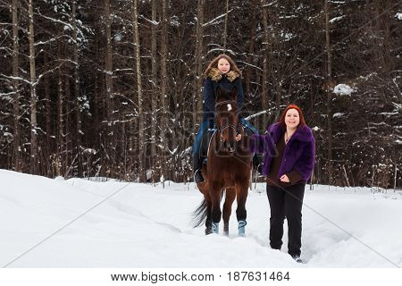 Teenager Girl, Mom And Horse In A Winter