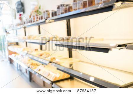 Blurred bakery shop background. pie bread cake donut