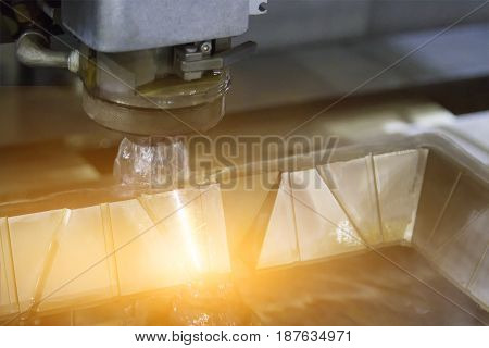 CNC wire cutter works in slender cutting of metal.