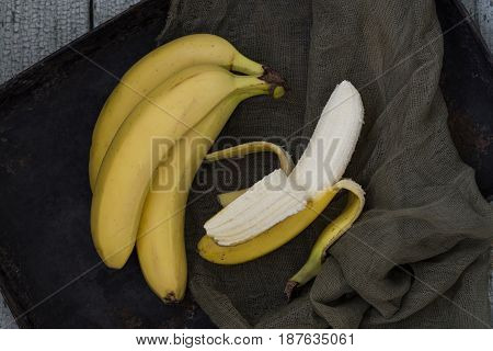 ripe yellow bananas on vintage wooden background
