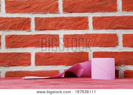 Toilet Paper On A Brick Wall Background