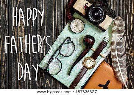 Happy Father's Day Text Sign On Compass And Glasses Pipe Watch Wallet On Black  Wooden Background To