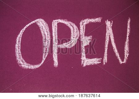 a open sign made chalk on a blackboard