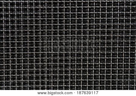 Close up of dark reflective metal square grid patterns and textures background
