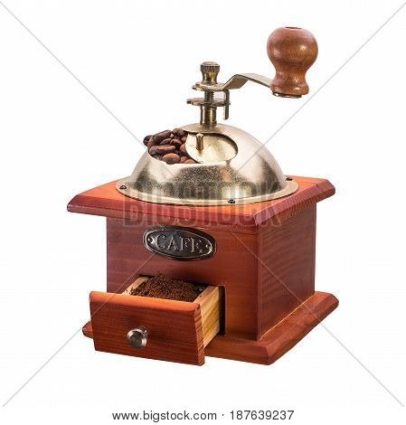 Vintage manual coffee grinder with coffee beans isolated on white