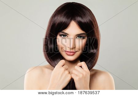 Happy Woman with Perfect Hair and Makeup. Beautiful Model with Healthy Hair Smiling
