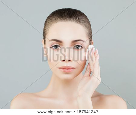 Beautiful Model Woman with Cotton Pads. Hygienic and Facial Treatment Concept